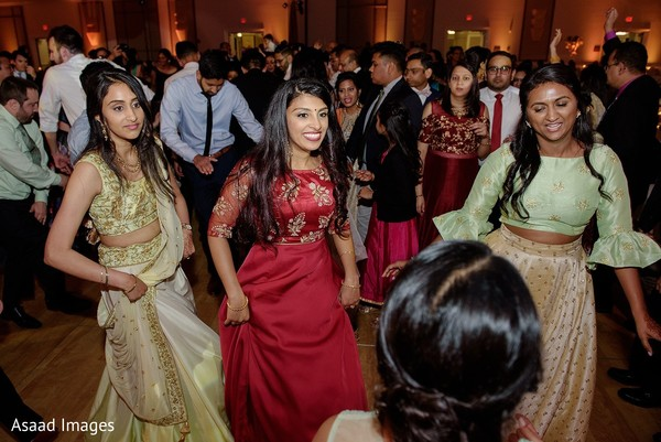 Indian bridesmaids dancing at reception party.