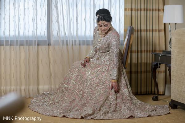 Enchanting Indian bride on her wedding dress.