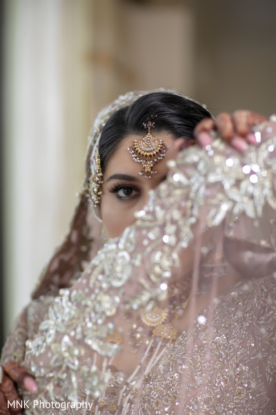Incredible Indian bridal ceremony tikka and wedding veil.