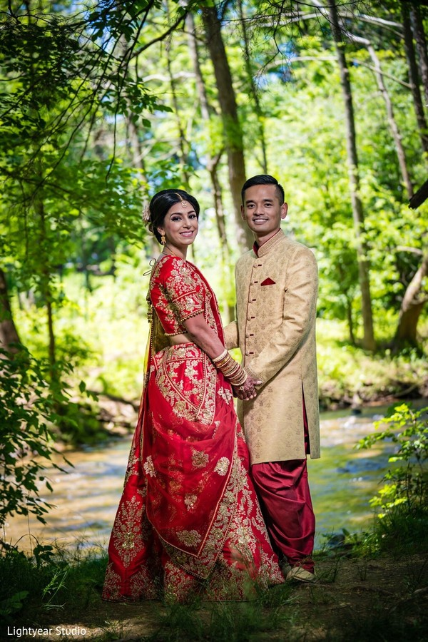 Indian couple in wedding attires during photo session.