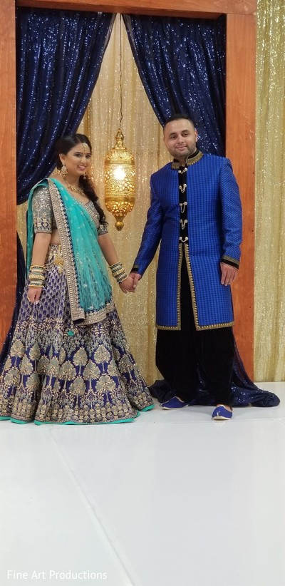 Indian bride and Raja wearing traditional Indian gala attires.