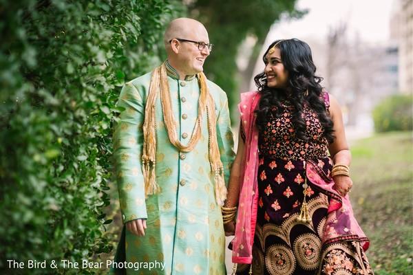 Maharani wearing the gorgeous maroon and coral saree.