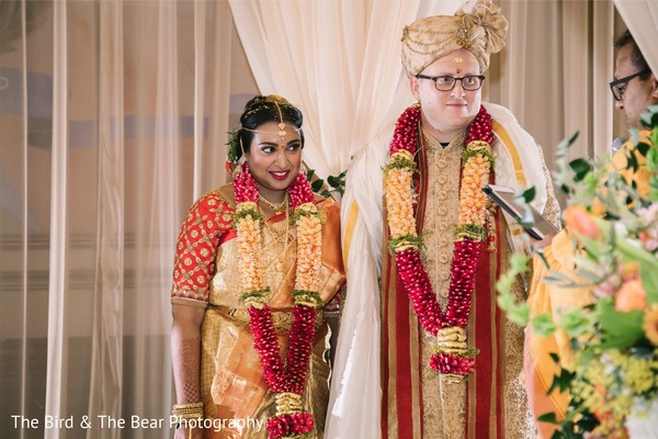 Indian newlyweds under the mandap during the ceremony.