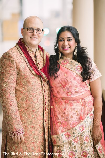 Indian bride and Raja posing for pictures with traditional attires.