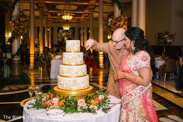 Indian groom cutting the Indian wedding cake with Maharani.