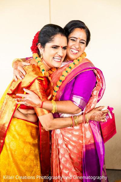 Maharani hugging a relative.