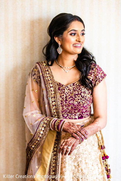 Indian bride posing for picture.