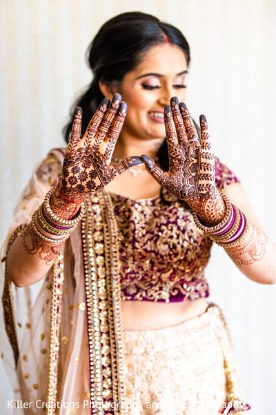 Maharani showing some mehndi art on her hands.