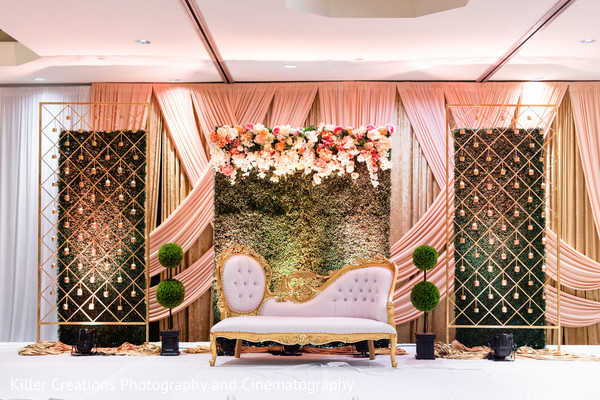 Stage decorated with flowers for Hindu reception.