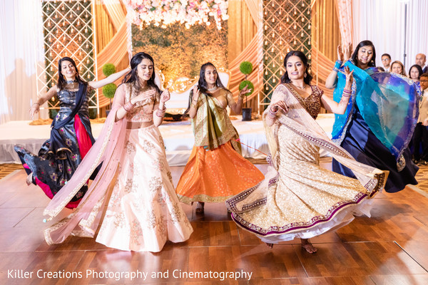 Indian bride and her Indian bridesmaids performing in the reception.
