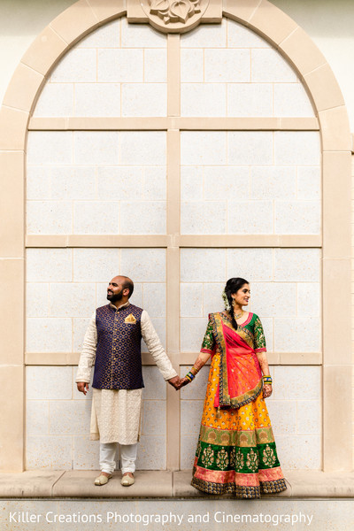 Indian couple wearing their Sangeet outfit.