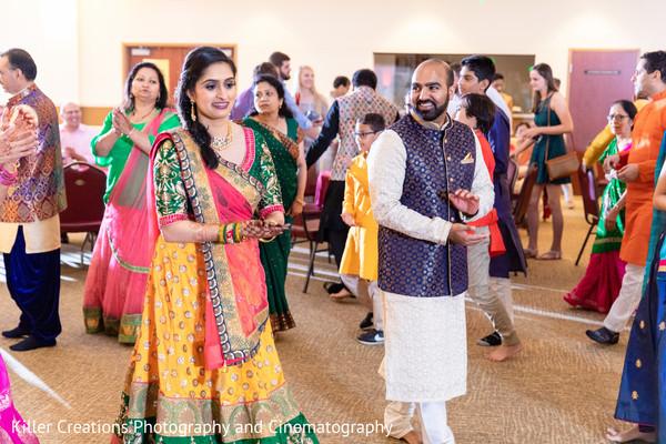 Maharani with a green saree and Indian groom with kurtha.