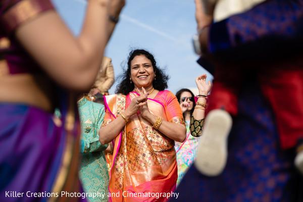 Indian relative smiling during the barat parade.