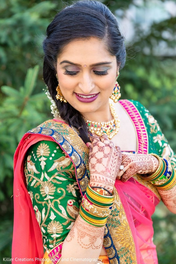 Indian bride wearing a green Saree.