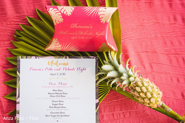 Indian pineapple decoration with favor box and menu card.