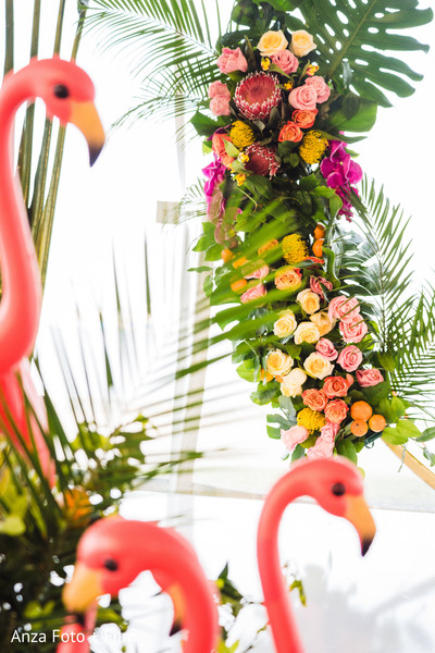 Yellow, pink and orange roses and decorations for Indian wedding.