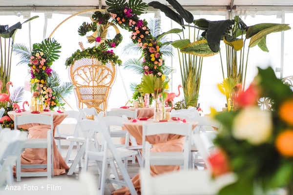 Indian pre-wedding stage tropical flowers decorations.