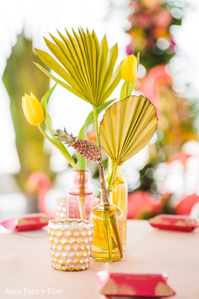 Indian wedding tulips and palms table decorations.