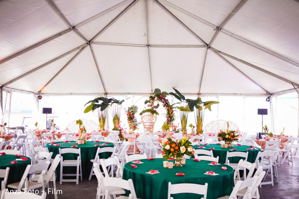 Indian wedding table setup in white tent.