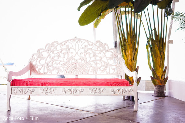 Indian wedding white and red wooden seat.