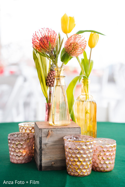 Indian wedding Yellow and orange tropical flowers table centerpiece.