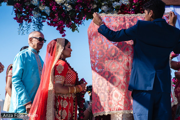 Indian bride arriving at ceremony Kanya Aagman.