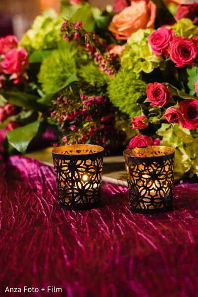 Golden Indian wedding reception table candle holders.