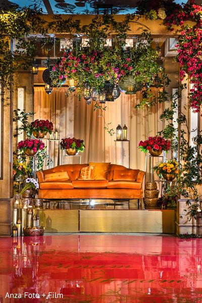 Orange seat for Indian wedding reception stage.