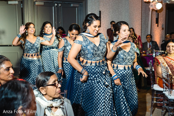Indian bridesmaids on their blue and silver reception lehengas.