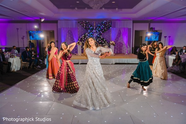 Indian bride and Maharanis performing a choreography.