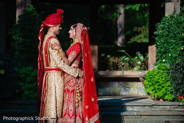 Indian groom holding the Maharani during the photoshoot.