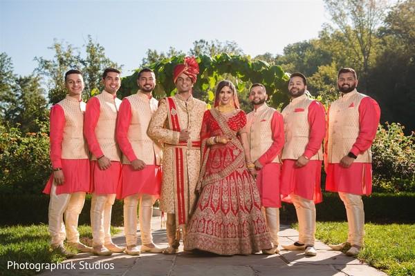 Raja and Maharani posing with groomsmen for the photoshoot.