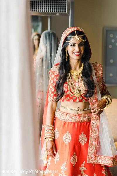 Indian bride displaying her Hindu wedding clothes.