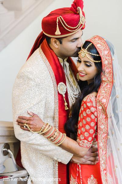 Indian couple wearing Hindu wedding attires.