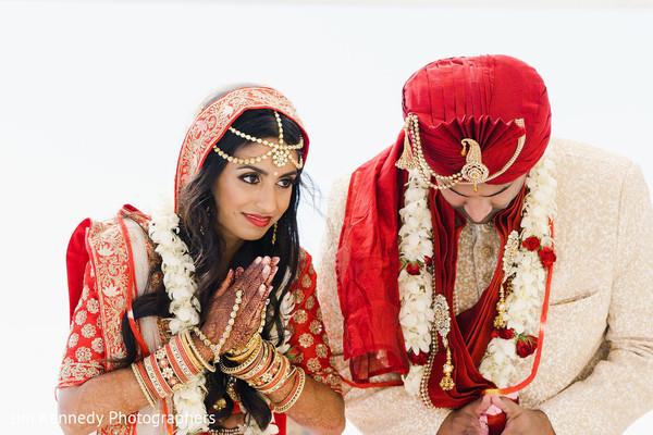 Maharani and her Indian groom praying during Hindu ceremony.