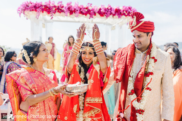 Indian couple walking out the hindu wedding ceremony.