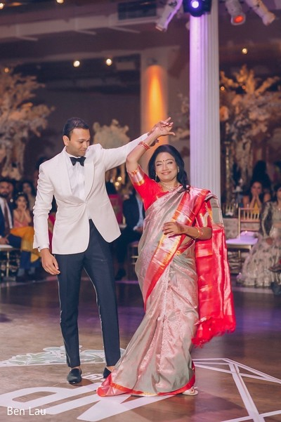 Indian groom dancing with a special guest during the reception gala.