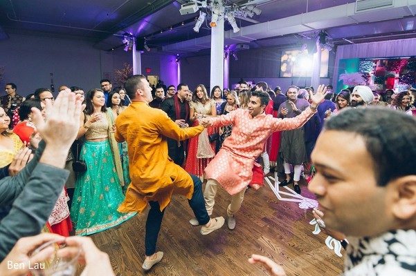 Guests on the dance floor during the Indian wedding celebrations.
