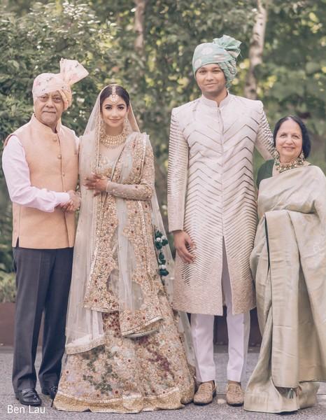 Maharani and Raja wearing the beige traditional wedding attires.