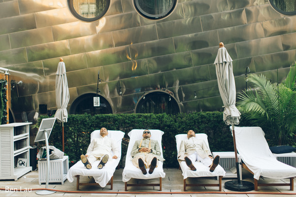 Raja and groomsmen having a relaxing moment after the ceremony.
