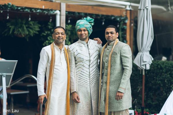 Raja wearing the traditional wedding sherwani and pagri posing.