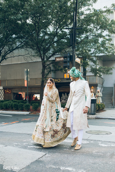 Indian bride and groom in the city during the photoshoot.