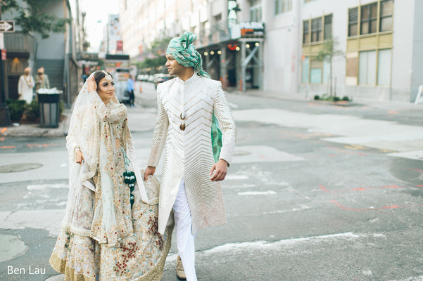 Indian groom assisting the Maharani during their photoshoot session.