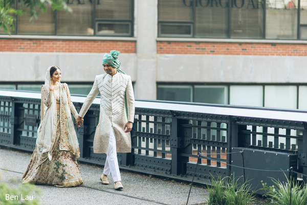 Maharani and Indian groom holding hands during the photoshoot.