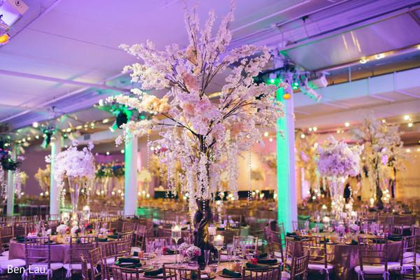 Floral arrangement centerpieces of the Indian wedding reception.