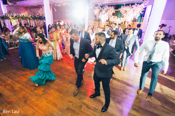 Guests performing a choreography during the Indian wedding reception.
