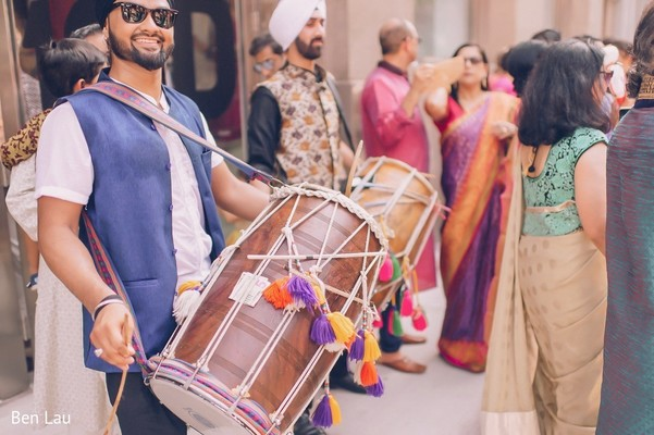 Dhol player during the Indian wedding baraat.