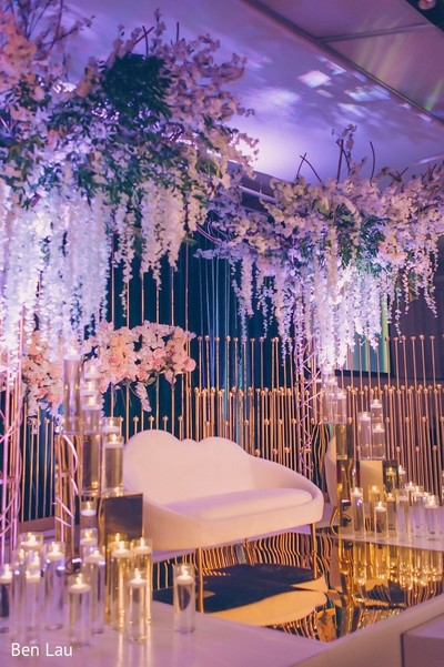 Lighting and floral decor of the Indian wedding reception venue.