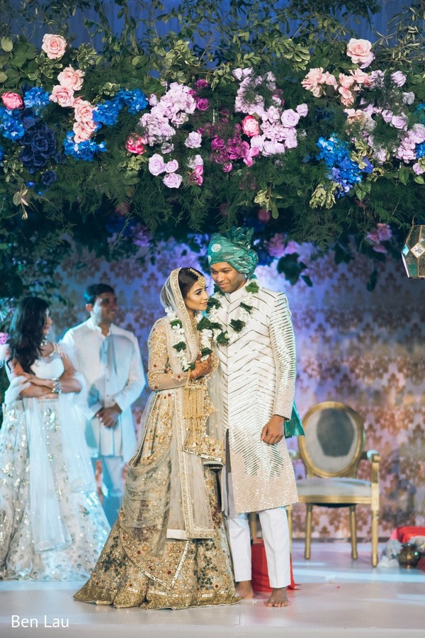 Indian couple after the ceremony under the floral mandap.