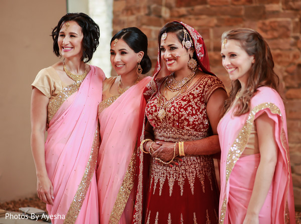 Maharani in red lengha with her Indian bridesmaids.